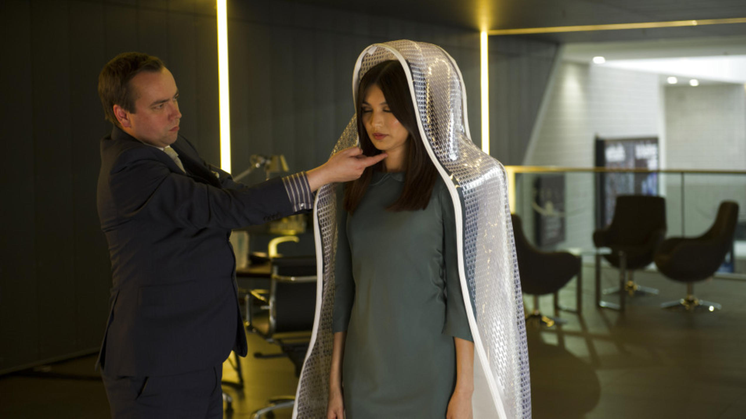 Episode 1.L-R  Salesman (Dan Tetsell) and Anita (Gemma Chan).